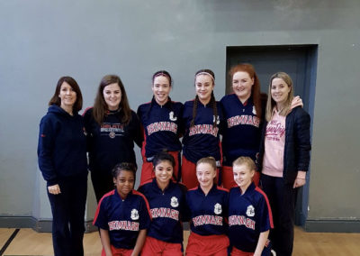 Basketball team with coaches Ms Hall and Ms Moran